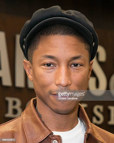 Musician Pharrell Williams signs his new book 'Happy' at Barnes Noble at The Grove on October 19 2015 in Los Angeles California