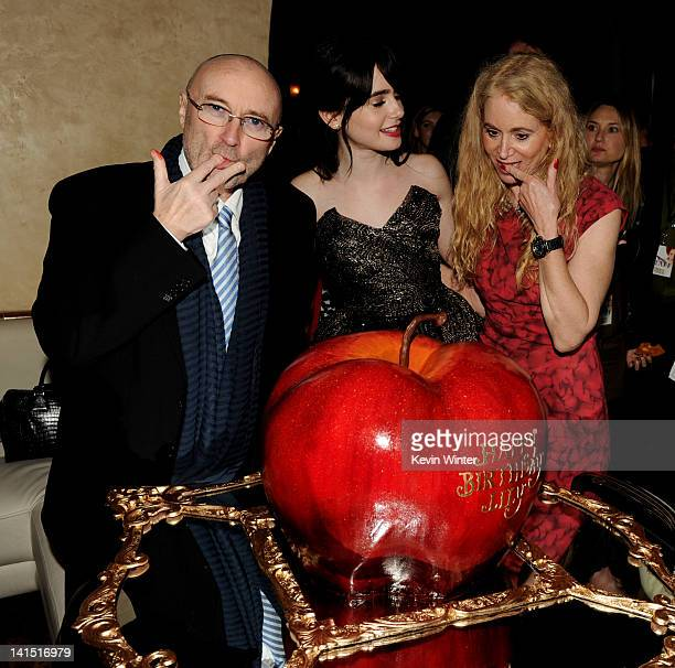 Musician Phil Collins his daughter actress Lily Collins and her mom Jill Tavelman pose with Lily's birthday cake at the after party for the premiere...