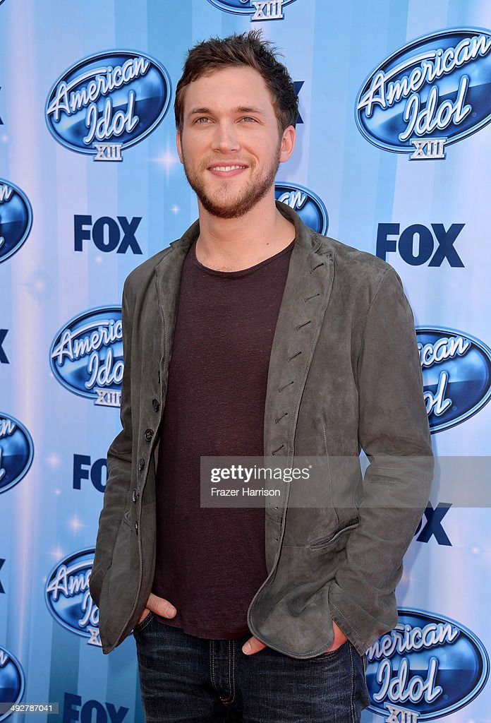 Musician <a gi-track='captionPersonalityLinkClicked' href=/galleries/search?phrase=Phillip+Phillips&family=editorial&specificpeople=1651494 ng-click='$event.stopPropagation()'>Phillip Phillips</a> attends Fox's 'American Idol' XIII Finale at Nokia Theatre L.A. Live on May 21, 2014 in Los Angeles, California.