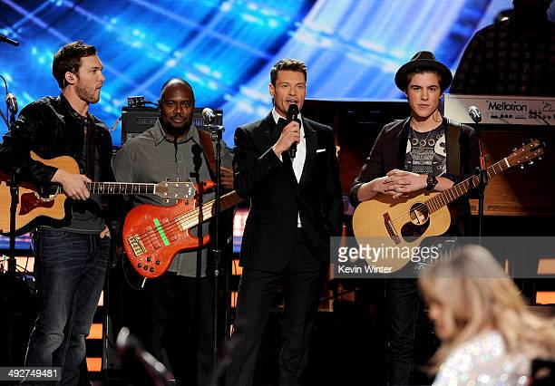 Musician Phillip Phillips host Ryan Seacrest and musician Sam Woolf perform onstage during Fox's 'American Idol' XIII Finale at Nokia Theatre LA Live...