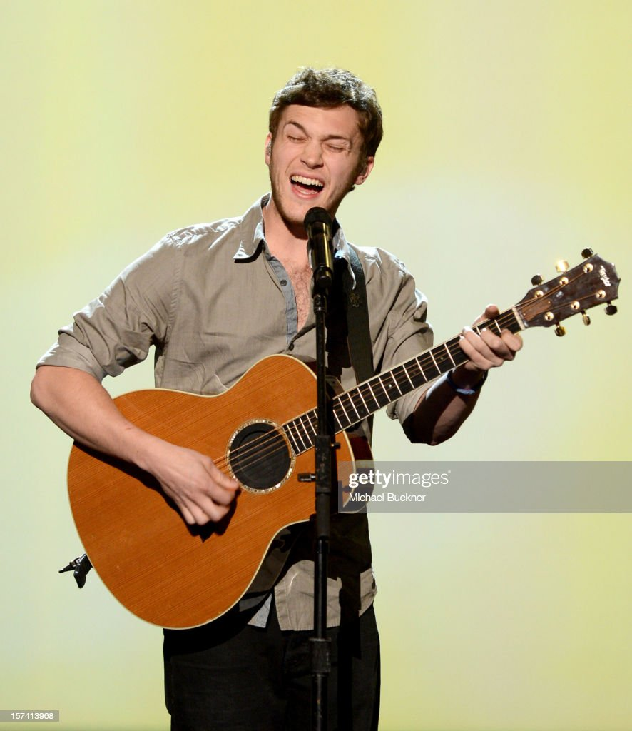 Musician <a gi-track='captionPersonalityLinkClicked' href=/galleries/search?phrase=Phillip+Phillips&family=editorial&specificpeople=1651494 ng-click='$event.stopPropagation()'>Phillip Phillips</a> performs onstage during the CNN Heroes: An All Star Tribute at The Shrine Auditorium on December 2, 2012 in Los Angeles, California. 23046_006_MB_0748.JPG