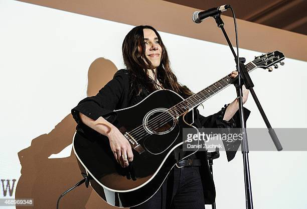 Musician PJ Harvey performs during the Sue Webster 'Folly Acres Cook Book' launch party at 458 Broome Street on April 8 2015 in New York City