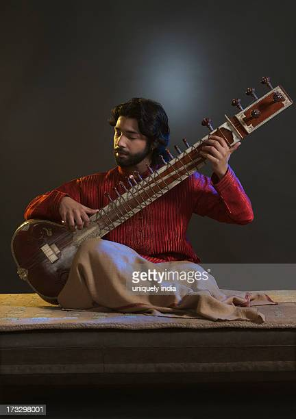 Musician playing a sitar