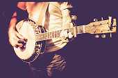 musician playing banjo in retro color  filter photo