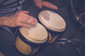 Close up of musician hands playing bongo drums
