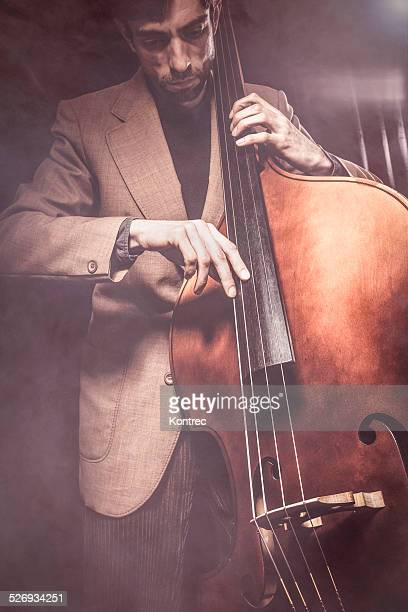 Musician playing double bass