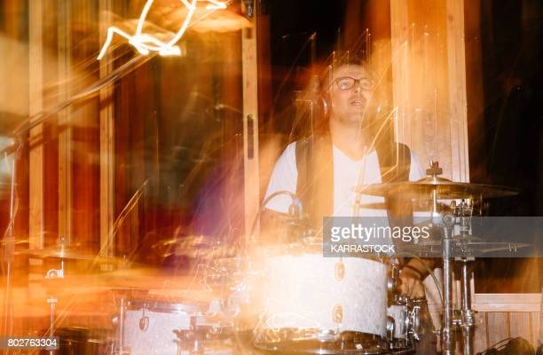 Musician playing drums at a concert