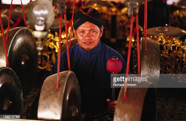 Musician playing gongs in gamelan orchestra in Sultan?†s Palace.