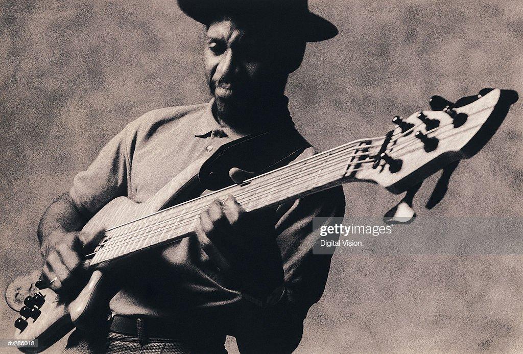 Musician playing guitar : Stock Photo