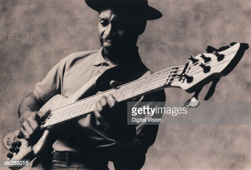 Musician playing guitar : Stock Photo