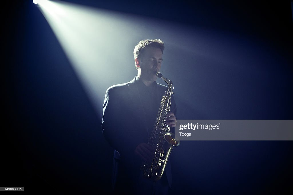 Musician playing saxophone on stage