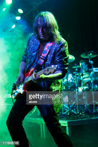 Musician playing the electric guitar on stage
