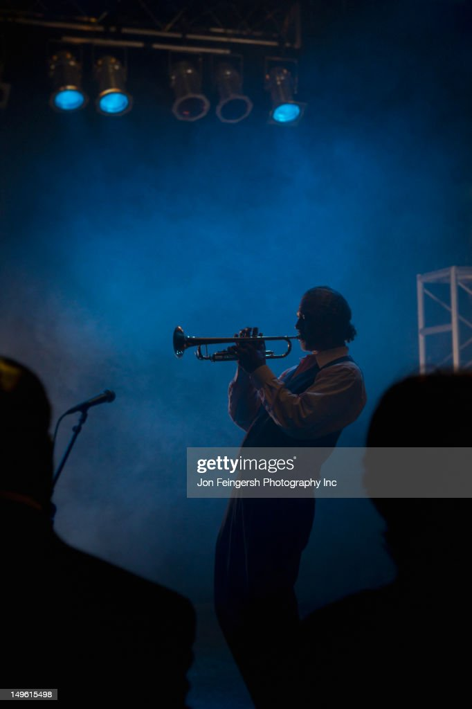 Musician playing trumpet on stage