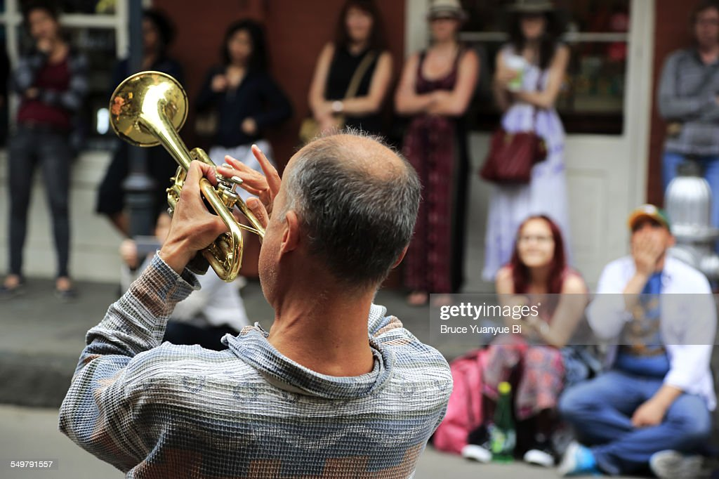 A musician playing trumpet on the street