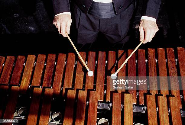 A musician plays a Marimba percussion instrument with a pair of single sticks circa 1998 in London