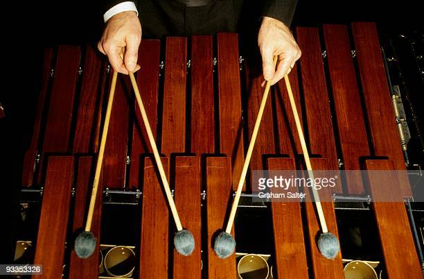 A musician plays a Marimba percussion instrument with two pairs of double sticks circa 1998 in London