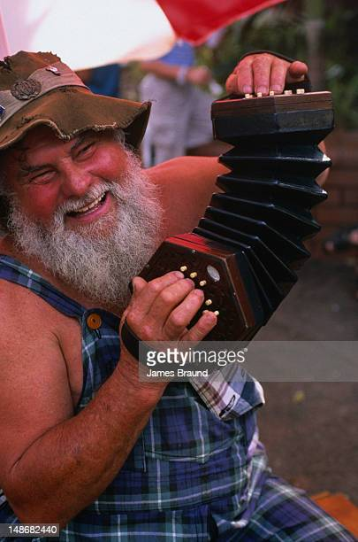 Musician plays accordion at Nightcliff market.