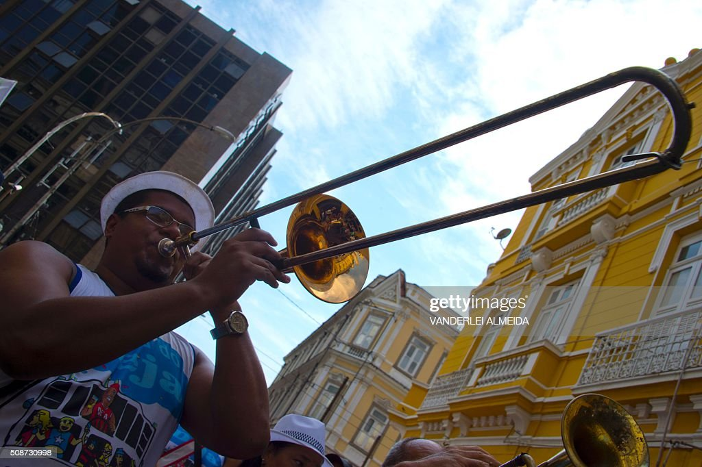 A musician plays his instrument during the traditional 'Cordao do Bola Preta' carnival band parade, in downtown Rio de Janeiro, Brazil, on February 6, 2016. Though Brazil's carnival will reach a fever pitch Sunday with Rio's flamboyant float competition, Brazilians have already started banging drums, dancing and singing in the sultry streets of Rio and across the country before the official start of what Brazilians dub 'The Greatest Show on Earth. AFP PHOTO / VANDERLEI ALMEIDA / AFP / VANDERLEI ALMEIDA
