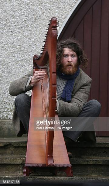 A musician plays the harp at the funeral of Therese MacGowan the mother of singer Shane MacGowan at Our Lady of Lourdes Church Silvermines Co...