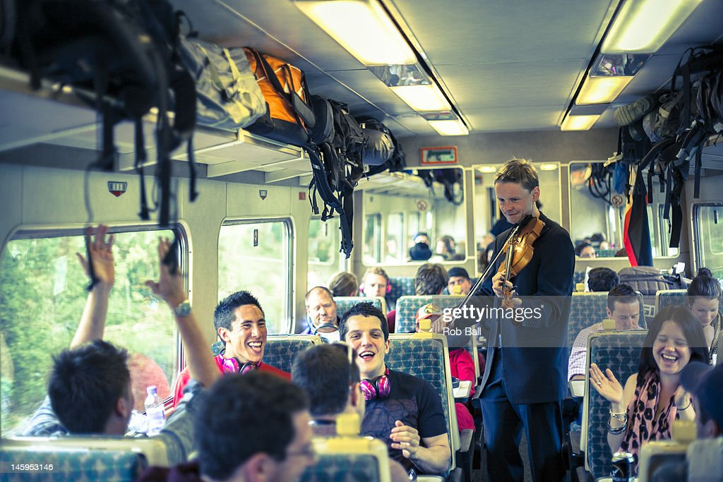 A musician plays the violin on board the Rockness Express Train heading to the RockNess festival at the Loch Ness Village of Dores on June 8, 2012 in Inverness, Scotland.