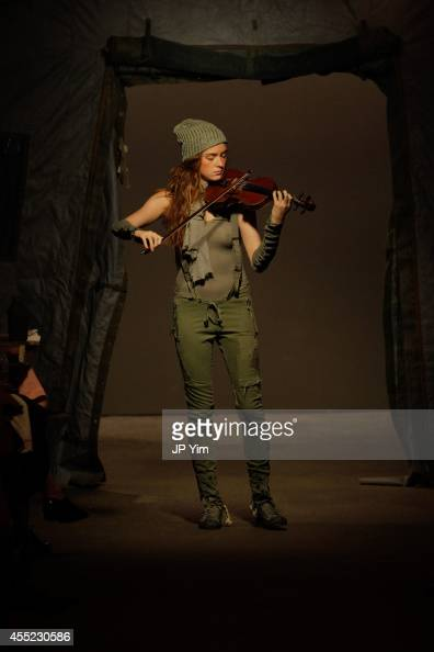 A musician plays the violin on the runway at the Greg Lauren SS15 Collection at the Eyebeam during MercedesBenz Fashion Week 2015 on September 10...