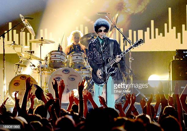 Musician Prince performs onstage during the 2013 Billboard Music Awards at the MGM Grand Garden Arena on May 19 2013 in Las Vegas Nevada