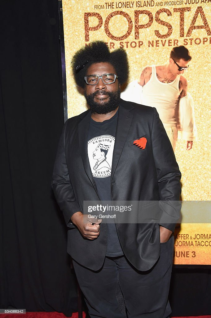 Musician <a gi-track='captionPersonalityLinkClicked' href=/galleries/search?phrase=Questlove&family=editorial&specificpeople=537550 ng-click='$event.stopPropagation()'>Questlove</a>, sneaker detail, attends the 'Popstar: Never Stop Never Stopping' New York premiere at AMC Loews Lincoln Square 13 theater on May 24, 2016 in New York City.