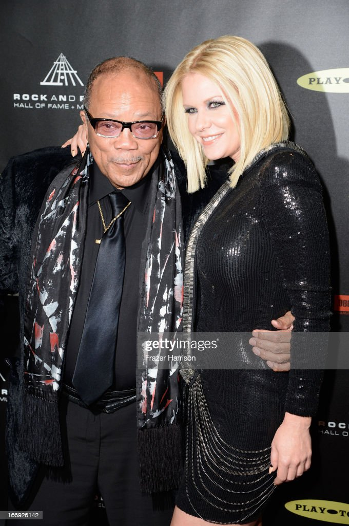Musician Quincy Jones and TV personality Carrie Keagan attend the 28th Annual Rock and Roll Hall of Fame Induction Ceremony at Nokia Theatre L.A. Live on April 18, 2013 in Los Angeles, California.