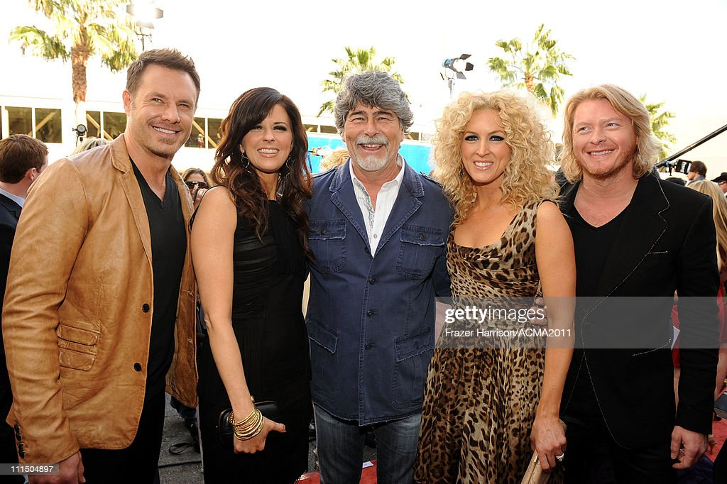 Musician Randy Owen of the group Alabama posese with musicians Jimi Westbrook Karen Fairchild Kimberly Schlapman and Phillip Sweet of the band Little...