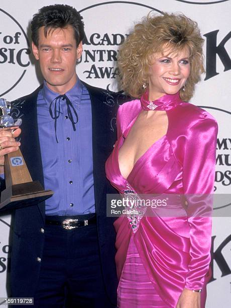 Musician Randy Travis and actress Markie Post attend the 23rd Annual Academy of Country Music Awards on March 21 1988 at Knott's Berry Farm in Buena...