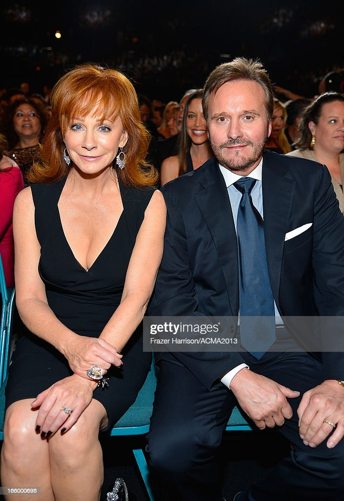 Musician Reba McEntire (L) and manager Narvel Blackstock attend the 48th Annual Academy of Country Music Awards at the MGM Grand Garden Arena on April 7, 2013 in Las Vegas, Nevada.