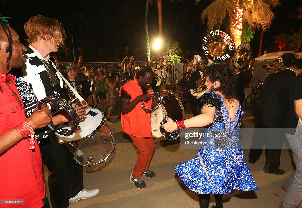 Musician Regine Chassagne (R) of Arcade Fire performs with members of Preservation Hall Jazz band in the crowd during day 3 of the 2014 Coachella Valley Music & Arts Festival at the Empire Polo Club on April 20, 2014 in Indio, California.