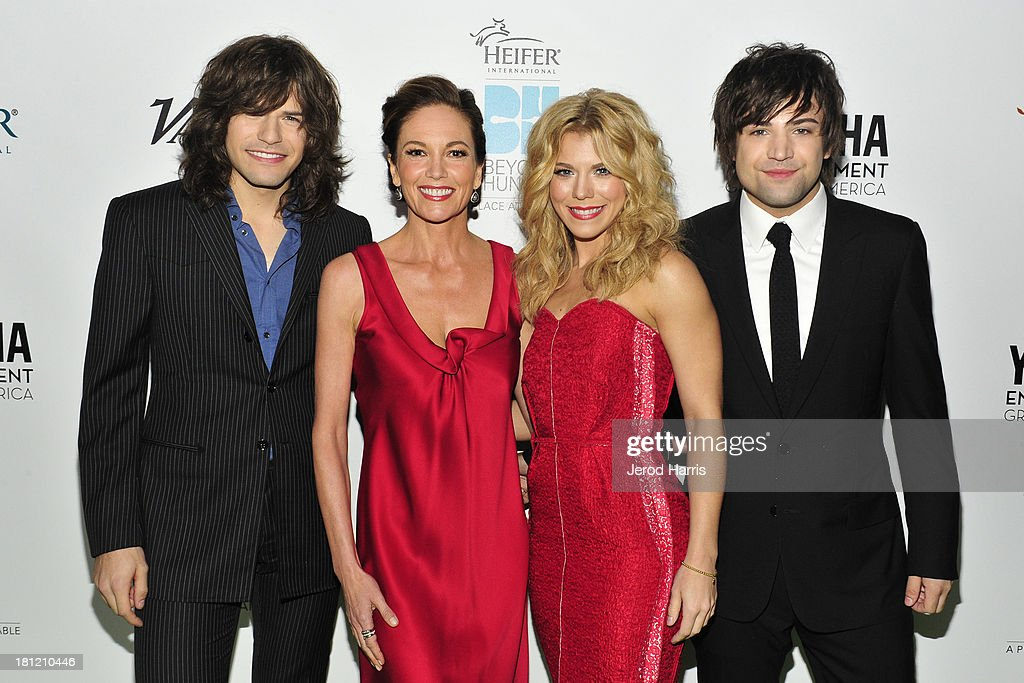 Musician Reid Perry, actress Diane Lane, musicians Kimberly Perry, and Neil Perry of The Band Perry attend Heifer International's 2nd Annual 'Beyond Hunger: A Place at the Table' to Help End World Hunger and Poverty at Montage Hotel on September 19, 2013 in Los Angeles, California.