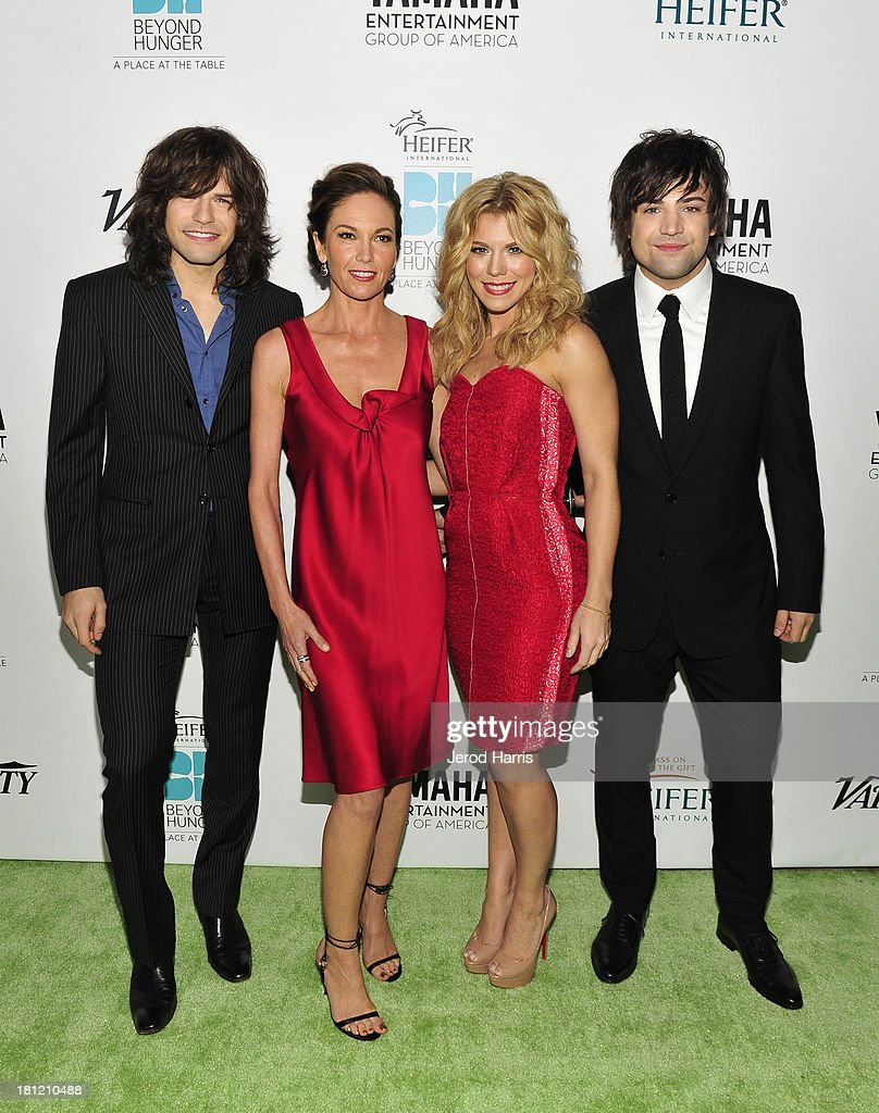 Musician <a gi-track='captionPersonalityLinkClicked' href=/galleries/search?phrase=Reid+Perry&family=editorial&specificpeople=6718326 ng-click='$event.stopPropagation()'>Reid Perry</a>, actress <a gi-track='captionPersonalityLinkClicked' href=/galleries/search?phrase=Diane+Lane&family=editorial&specificpeople=206364 ng-click='$event.stopPropagation()'>Diane Lane</a>, musicians <a gi-track='captionPersonalityLinkClicked' href=/galleries/search?phrase=Kimberly+Perry&family=editorial&specificpeople=6718325 ng-click='$event.stopPropagation()'>Kimberly Perry</a>, and Neil Perry of The Band Perry attend Heifer International's 2nd Annual 'Beyond Hunger: A Place at the Table' to Help End World Hunger and Poverty at Montage Hotel on September 19, 2013 in Los Angeles, California.