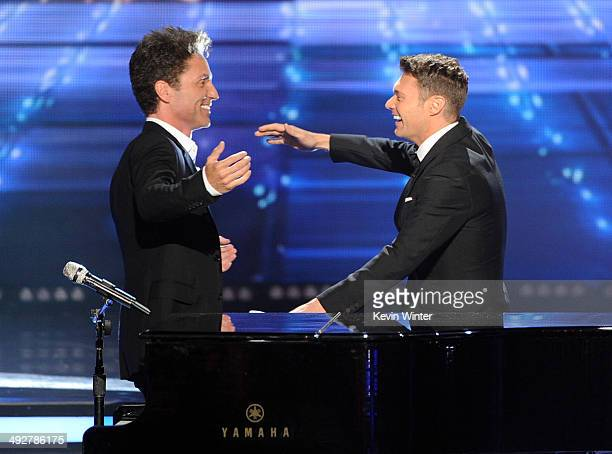 Musician Richard Marx and host Ryan Seacrest perform onstage during Fox's 'American Idol' XIII Finale at Nokia Theatre LA Live on May 21 2014 in Los...