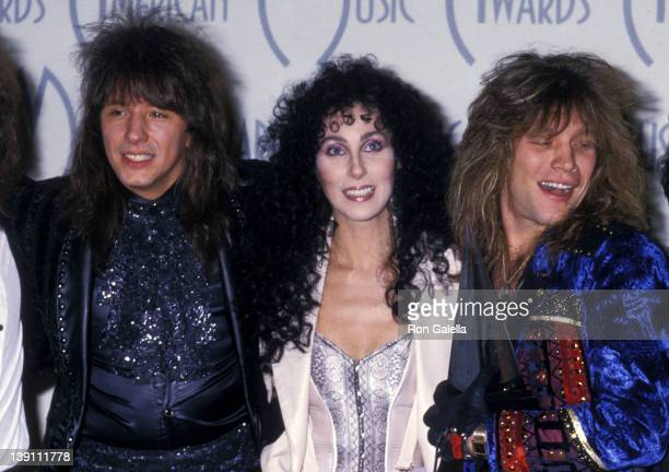 Musician Richie Sambora of Bon Jovi singer/actress Cher and musician Jon Bon Jovi of Bon Jovi attend the 15th Annual American Music Awards on January...