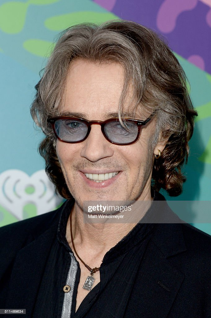 Musician Rick Springfield poses backstage during the first ever iHeart80s Party at The Forum on February 20, 2016 in Inglewood, California.
