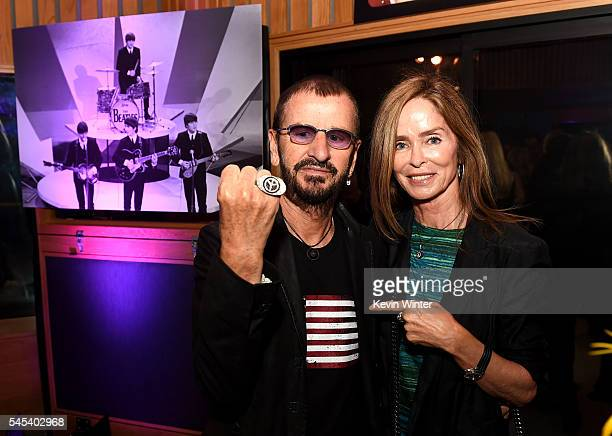 Musician Ringo Starr and his wife Barbara Bach pose at Ringo Starr's 'Peace Love' birthday celebration at Capitol Records on July 7 2016 in Los...