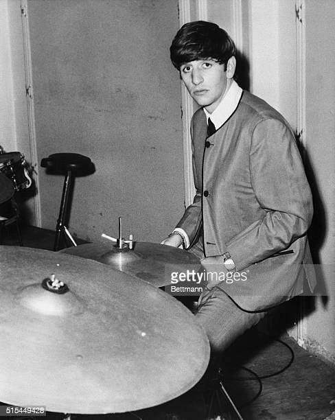 Musician Ringo Starr of The Beatles playing the drums in 1963