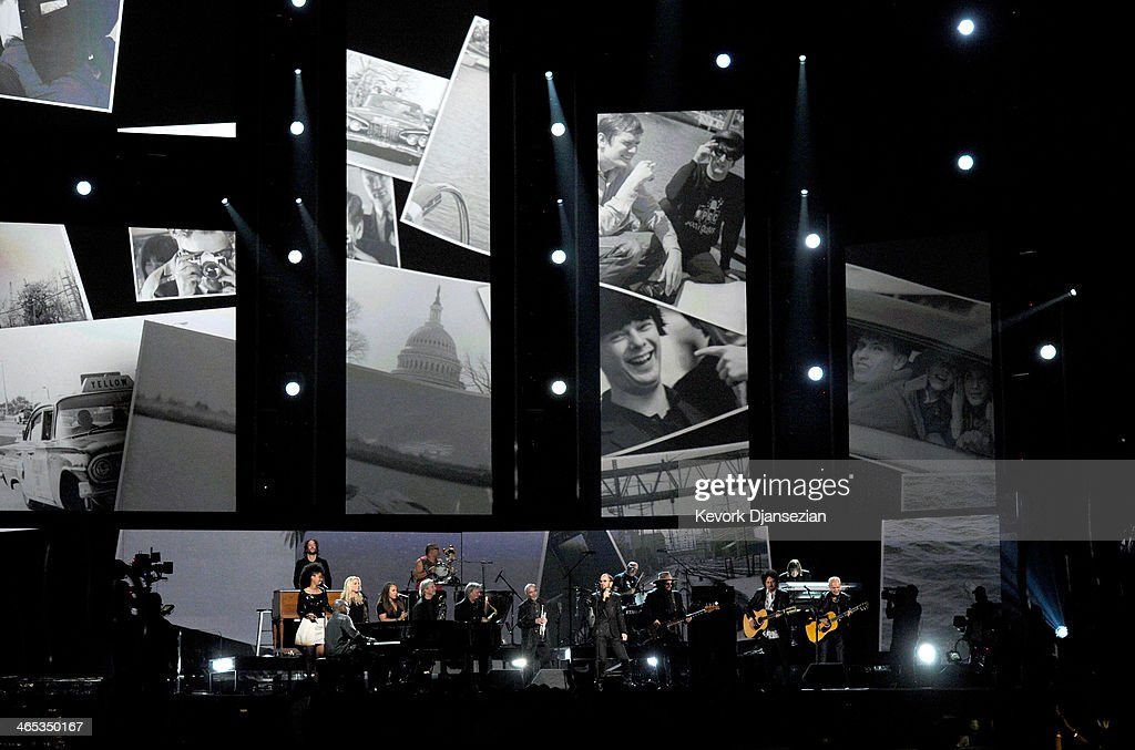 Musician <a gi-track='captionPersonalityLinkClicked' href=/galleries/search?phrase=Ringo+Starr&family=editorial&specificpeople=92463 ng-click='$event.stopPropagation()'>Ringo Starr</a> (C) performs onstage during the 56th GRAMMY Awards at Staples Center on January 26, 2014 in Los Angeles, California.