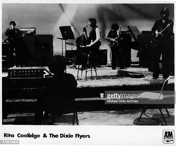 Musician Rita Coolidge and her band Rita Coolidge And The Dixie Flyers record in the studio in circa 1971