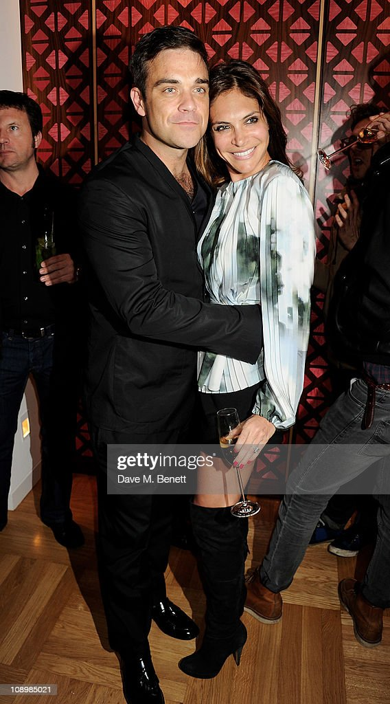 Musician Robbie Williams and Ayda Field attend the launch of luxury brand Spencer Hart at Selfridges on February 10 2011 in London England