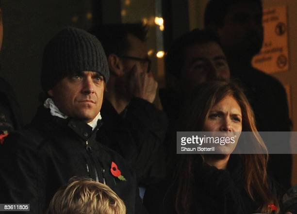 Musician Robbie Williams girlfriend Ayda Field look on from the stand during the Barclays Premier League match between Arsenal and Manchester United...