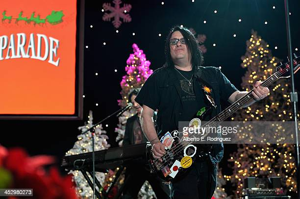 Musician Robby Takac of the Goo Goo Dolls performs at the 82nd Annual Hollywood Christmas Parade on December 1 2013 in Hollywood California