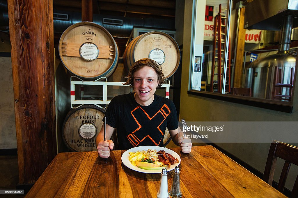 Musician Robert DeLong eating breakfast at Elysian Fields before his End Session for 107.7 The End on March 16, 2013 in Seattle, Washington.