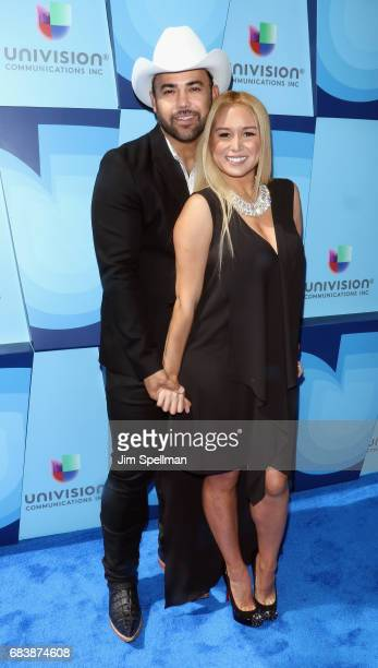 Musician Rogelio Martinez and Lisa Marie Martinez attend Univision's 2017 Upfront at the Lyric Theatre on May 16 2017 in New York City