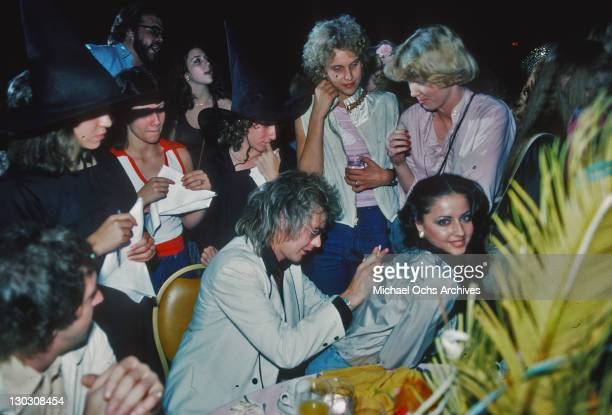 Musician Roger Taylor of British rock band Queen signs an autograph for a fan 1978