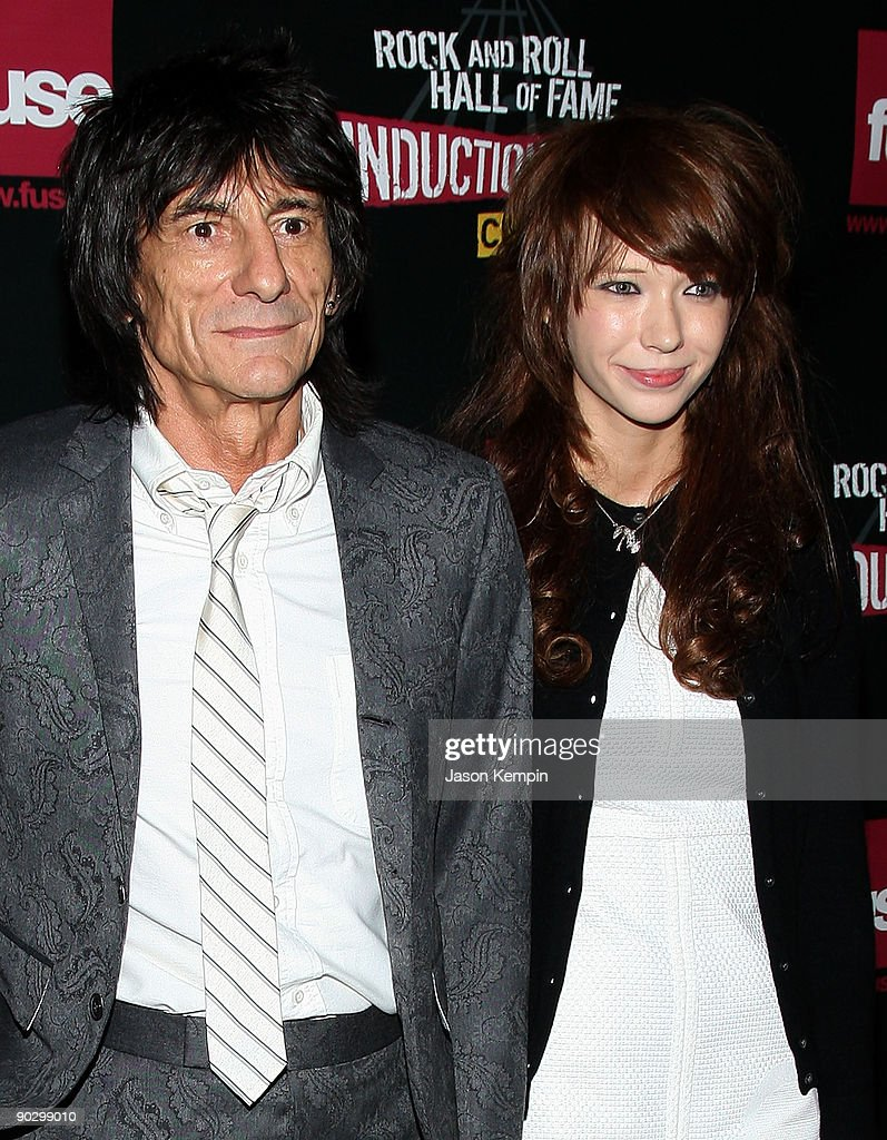 Musician Ron Wood of the Rolling Stones and Ekaterina Ivanova attend the 24th Annual Rock and Roll Hall of Fame Induction Ceremony at Public Hall on April 4, 2009 in Cleveland, Ohio.