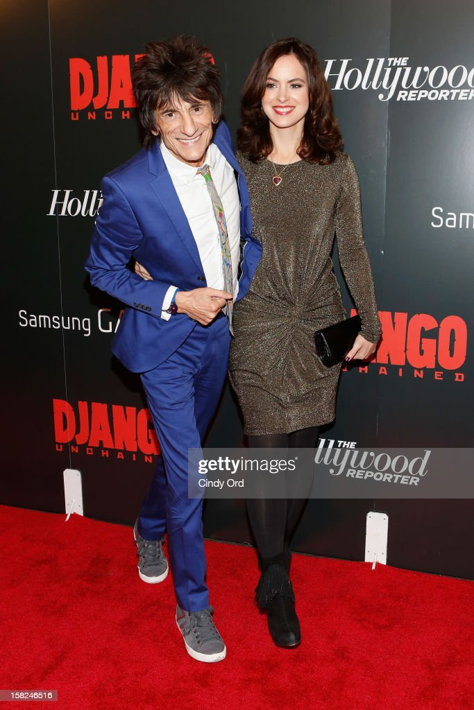Musician Ronnie Wood (L) and Sally Humphreys attend the Django Unchained NY premiere at Ziegfeld Theatre on December 11, 2012 in New York City.