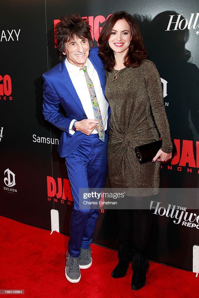Musician Ronnie Wood and Sally Humphreys attend The Weinstein Company With The Hollywood Reporter, Samsung Galaxy And The Cinema Society Host A Screening Of 'Django Unchained' at Ziegfeld Theater on December 11, 2012 in New York City.
